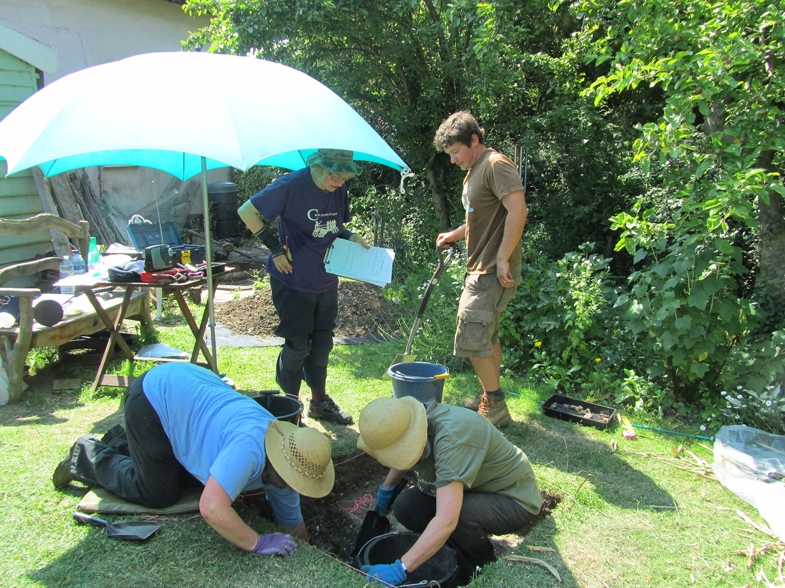 Volunteers working on one of the test pits in Hoxne