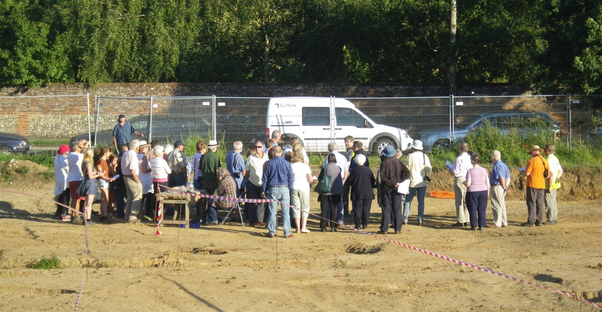Visitors at an excavation open day on the outskirts of Clare, Suffolk