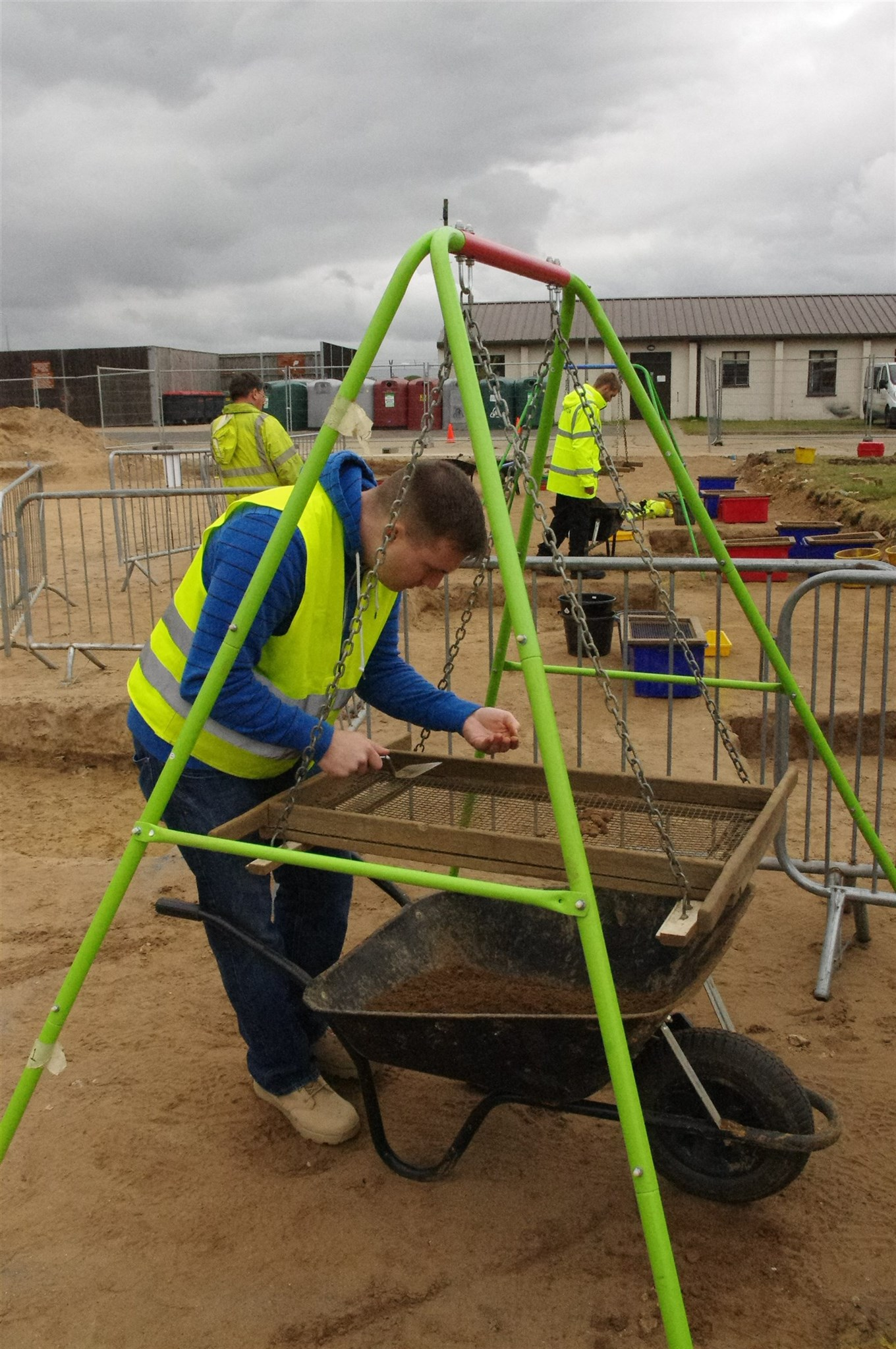 A volunteer sieving spoil at the RAF Lakenheath community excavation