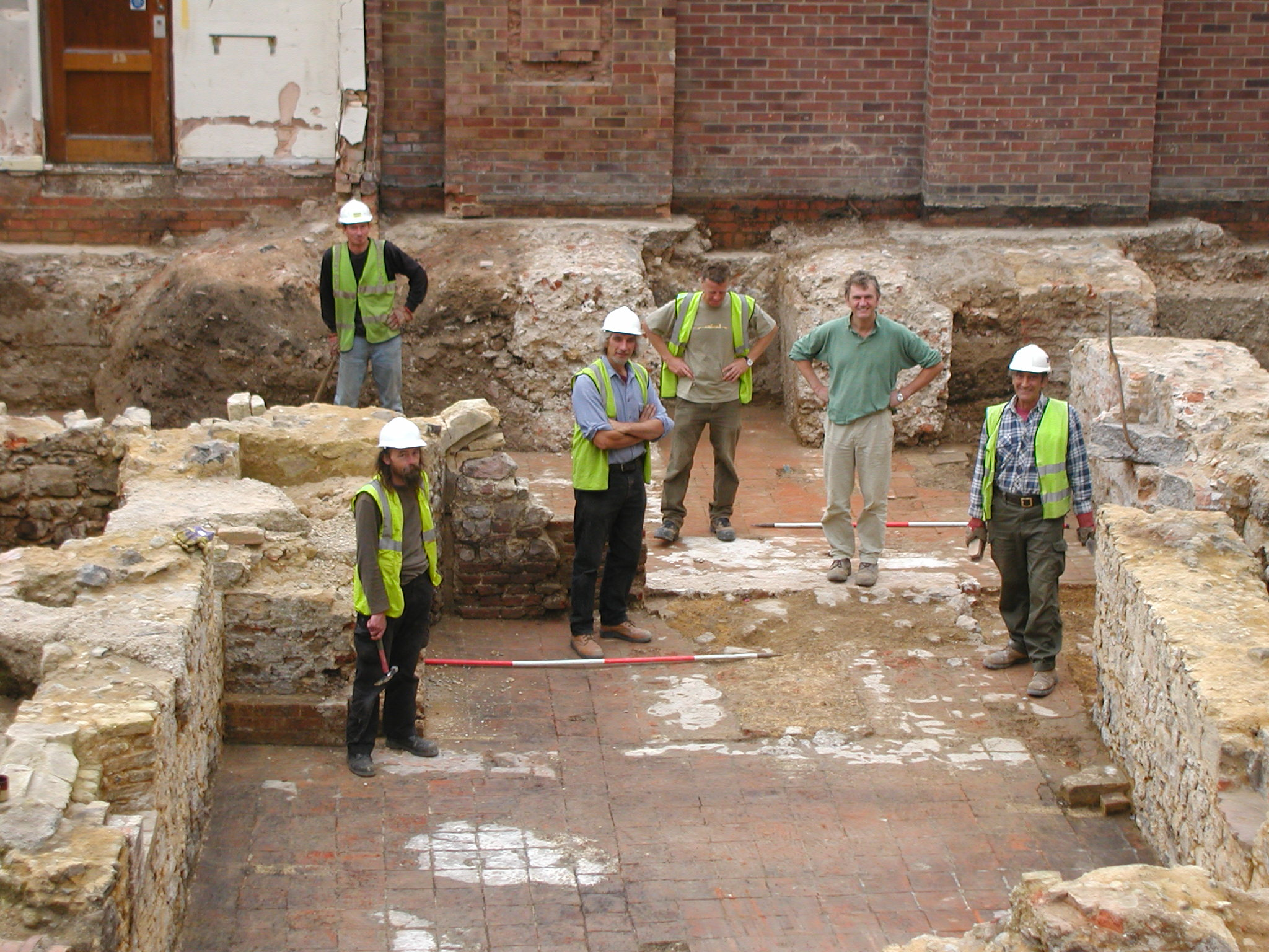 The excavation team within post-medieval cellars during excavations at Ipswich waterfront