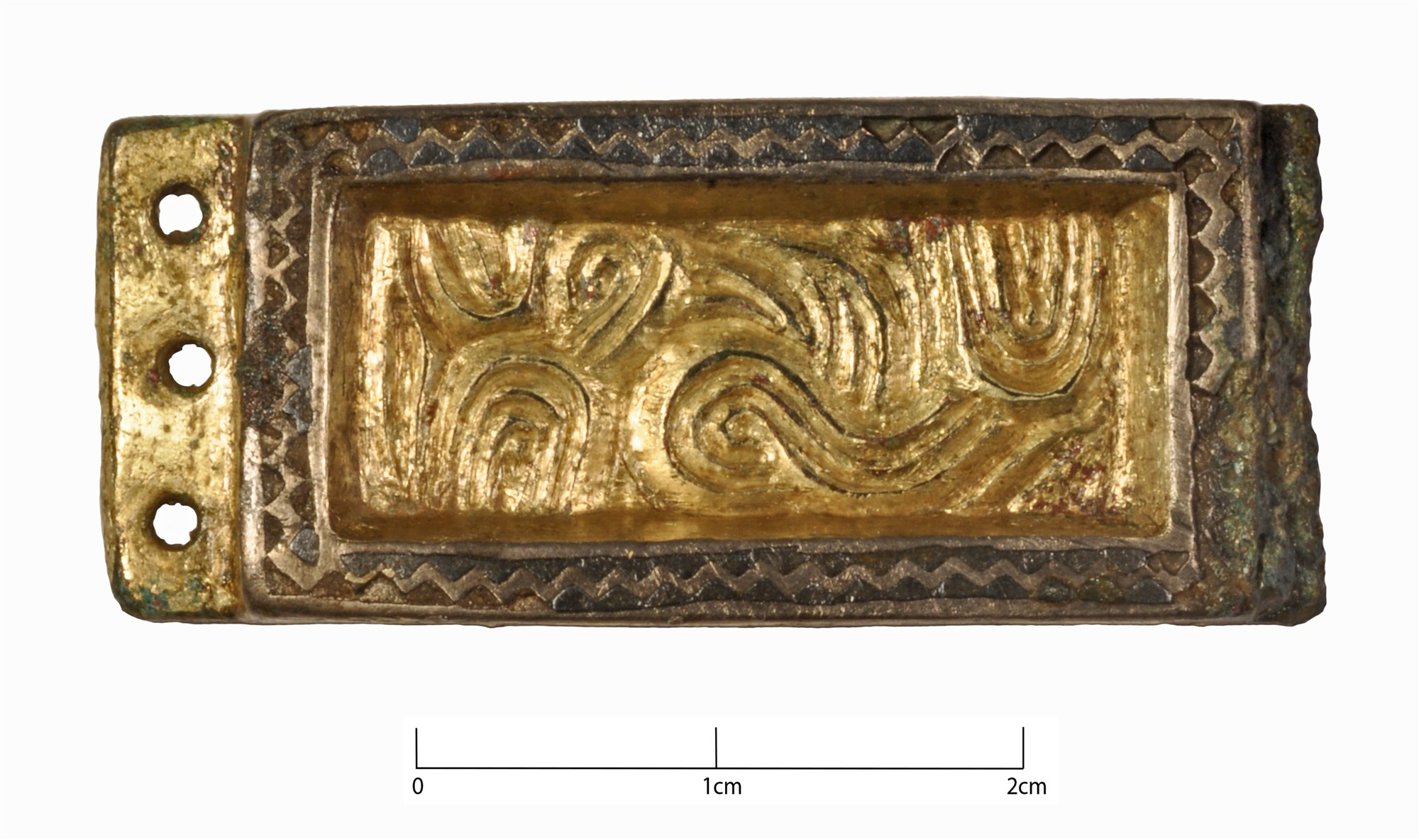 Anglo-Saxon copper alloy gilded buckle mount - after cleaning and conservation