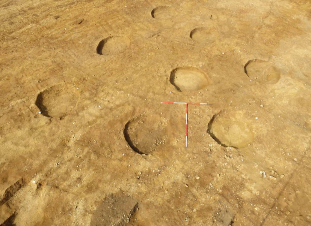 A group of Iron Age storage pits after excavation