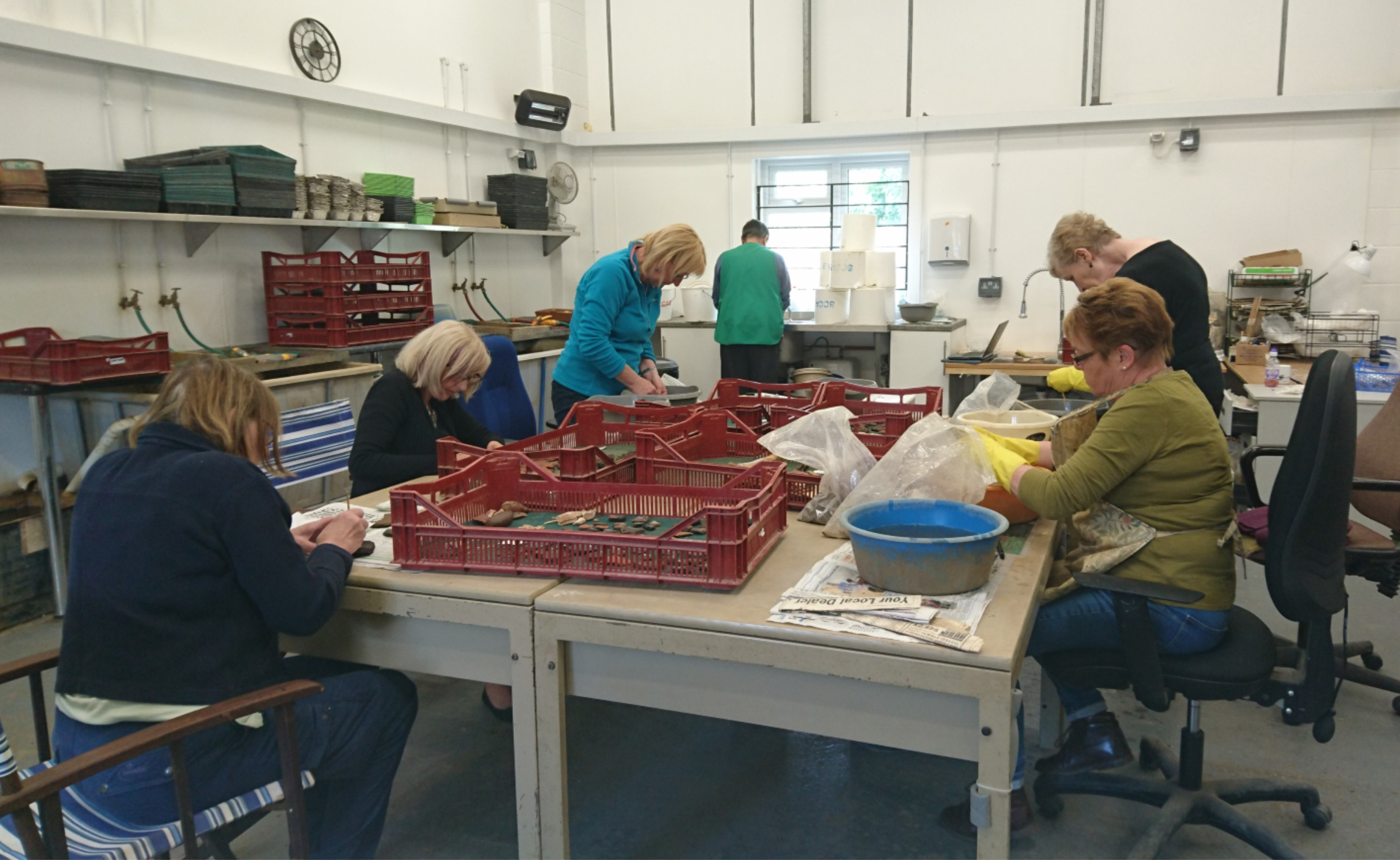Volunteers processing and marking finds from the excavation