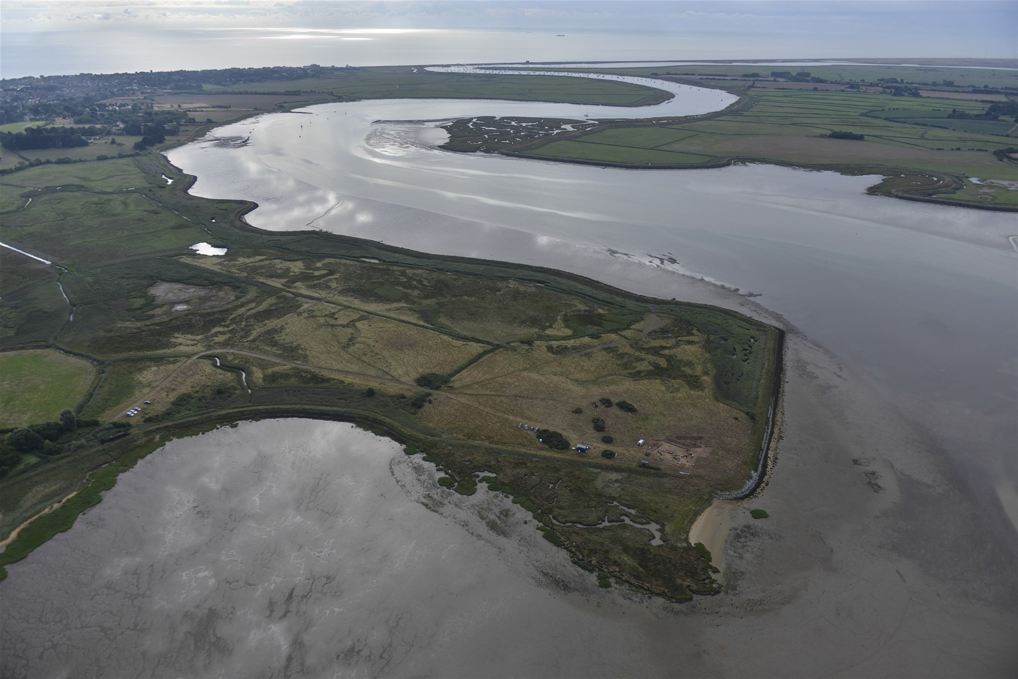 Aerial view of Barbers Point and the River Alde, with the excavation site in the foreground