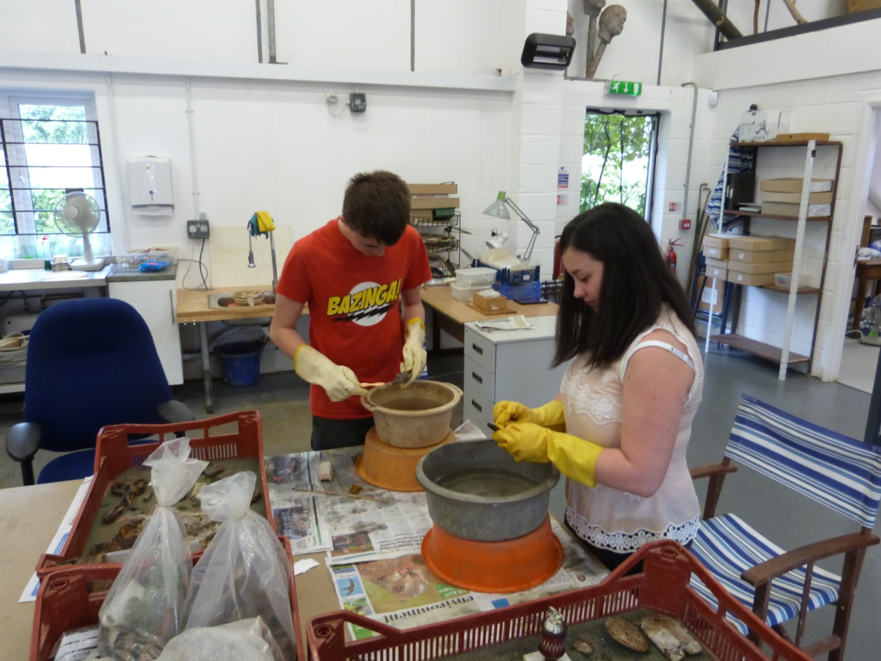 Work experience students carrying out finds processing