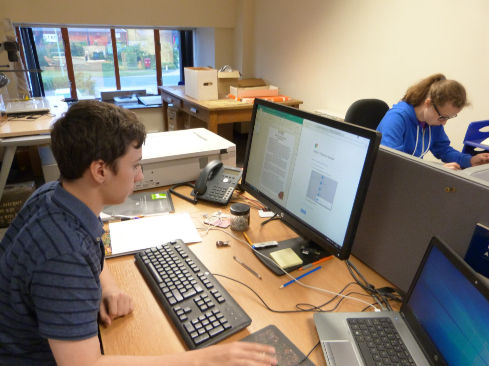 Work experience students in the office